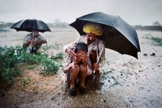 India | Farmers experience the monsoon as an almost religious experience as they watch their fields come backto life after being parched for half t... | -Steve McCurry-