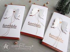 Weihnachtliche Schokolade wurde mit einer Banderole versehen, die mit den Pop-up-Engelsflügeln von Creative-Depot gestanzt ist. (Werbung) ...