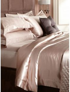 Silk and satin fabrics are glamorous and luxurious. Try silk or satin pillows, duvet, pillowcases, or a silk throw blanket in a rich color.