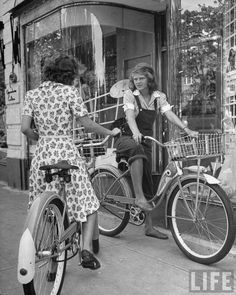 1942 Girls stopping to talk on their bicycles. Garden City.
