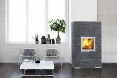 The Vasa fireplace is a smaller version of the popular Valkia series and is very effective. The simple stone surface and the square door on the surface of the fireplace give it a serene appearance. The modern metal door frame beautifully borders the dancing flames within. The compact size of this fireplace makes it easy to position in any room.  The Grafia surface finish adds a texture to the surface of the soapstone that has never been seen before.