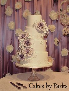 white wedding cake with purple flowers, romantic