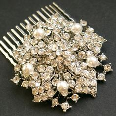 "etsy luxedeluxe                                                                                       A beautiful vintage style rhinestone flower is embellished with Swarovski pearls and fixed to a silver plated comb. Comb measures 1.75"" wide, rhinestone flower measures 2 and 1/8"""