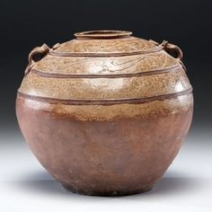 Lot: Chinese Han Dynasty Proto-Porcelain Jar, Lot Number: 0056, Starting Bid: $1,000, Auctioneer: Cowan's Auctions, Inc., Auction: Asian Art: Live Salesroom Auction, Date: September 12th, 2014 PDT