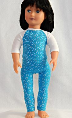 12.00 USD  These blue circle pajamas could double as a yoga outfit for a trip to the yoga studio. As PJ's they are just the right outfit to get your slumber party started! Your little girl will be delighted when she dresses up her favorite 18 inch doll in these classic PJs (or Yoga outfit). Handcrafted with white and blue jersey fabric the circles get bigger as you go down the pants. The purchase of this listing is for one pair of white and blue doll pajamas with the following…