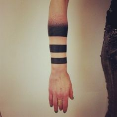 Rings tattooed on the arm