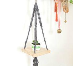 Check out this item in my Etsy shop https://www.etsy.com/il-en/listing/515954358/black-macrame-shelf-hanging-plant-shelf