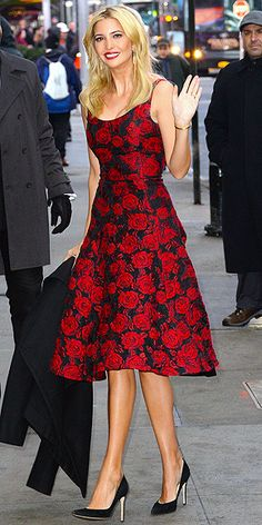 Love Her Outfit! Sparkly Star Looks to Steal | IVANKA TRUMP | For that New Year's Eve wedding you have (where you're confident the bride won't mind being upstaged) try a knockout dress like Ivanka's red-rose embroidered A-line Oscar de la Renta number, which she wore to Good Morning America. She polishes the look off with extremely classic gold accessories, black pumps (all her own design) and a perfectly matched red lip.