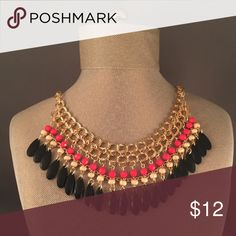 Bib Statement Necklace Gorgeous coral, black, and gold statement necklace. Bib style necklace, great for a Christmas gift or (for yourself!) featuring versatile colors that are perfect for both winter and fall! Not from listed brand. ASOS Jewelry Necklaces