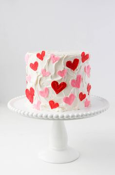 valentines day cake Learn how to make a sweet and simple chocolate candy hearts cake! Youll never guess the highly sophisticated set of tools I used to make the hearts. Pretty Birthday Cakes, Pretty Cakes, Cute Cakes, Beautiful Cakes, Amazing Cakes, Heart Birthday Cake, Dessert Design, Heart Cakes, Valentines Day Cakes