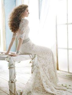 I adore the open back, natural waist line, and, lace in this Jim Hjelm wedding dress.