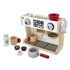 Create your own cafe experience at home with this barista machine from I'm Toy. A chalkboard for writing specials and a mini menu is printed on the back. The printed menu helps little ones to practice counting and learn about portion size.