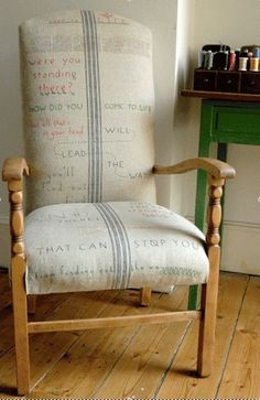 front view...A high back wooden armchair, covered in vintage French sack. Sally hand embroidered the words which were designed by Peter, from a poem by Sadie Nencini.
