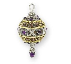 An enamel and gem-set commemorative pendant, by Boucheron, 1911  The finely pierced openwork pendant of spherical form, set with three horizontal bands, the upper and lower bands in red enamel and inscribed 'Madras Camp' and 'Delhi Durbar', the central band set with rose-cut diamonds denoting the date 1911 in Roman numerals, with cabochon amethyst detail and drop, unsigned, in a fitted Boucheron case, the exterior of the case inscribed 'Delhi Durbar 1911'