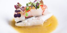 This sea bass recipe from the Costardi Brothers uses a delicious combination of seafood, including prawns and scallops, to make a perfect seafood starter.
