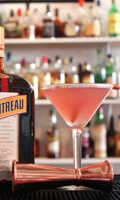 Cosmopolitan cocktail Recipe: - 1 1/2 oz Citron Vodka - 3/4 oz Cointreau - 1/2 oz Fresh Lime Juice - 1 oz Cranberry Juice Glass: Chilled cocktail/ Martini Ice: None Method: Shake and fine strain Garnish: Orange zest