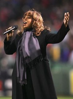 BOSTON - OCTOBER 24: Donna Summer sings God Bless America in the seventh inning stretch of game two of the World Series between the Boston Red Sox and the St. Louis Cardinals on October 24, 2004 at Fenway Park in Boston, Massachusetts.