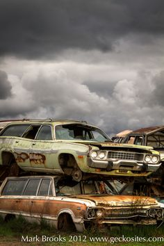 A couple old station wagons under a stormy sky.  Photo taken by Mark Brooks - www.geckosites.com , www.facebook.com/photographybymarkbrooks  - automotive photography and more