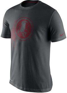 This Nike NFL Travel Dri-FIT t-shirt is a subtle charcoal gray with Washington Redskins graphics at the front. The only thing that could make this tee more comfortable and more supportive is your team winning on game-day! Crew neckline Short sleeves Screen print team logo at front Screen print Nike swoosh logo at left sleeve Regular fit Dri-FIT technology Tagless Cotton/polyester Machine washable