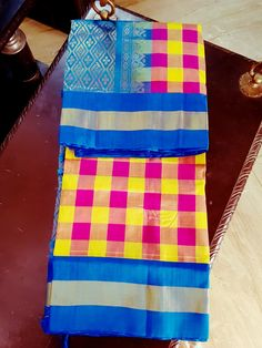 RICH SILK COTTON WITH YELLOW PINK CHECKS  WITH BRIGHT BLUE BORDER AND PALLU  SHOP NOW AT WWW.PARIJATSTORE.COM WATS UP AT 9500094822 Picnic Blanket, Outdoor Blanket, Silk Cotton Sarees, Yellow, Blue, Shop Now, Bright, Pink, Shopping