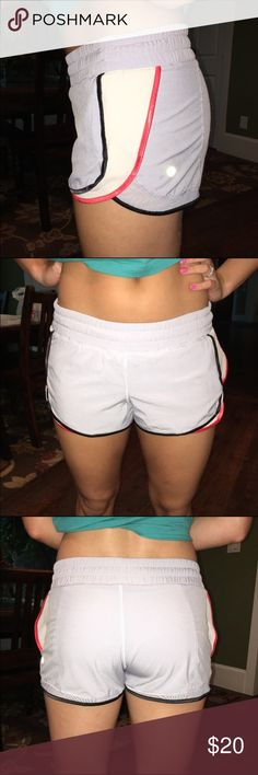 Lululemon light gray/silver shorts Lululemon light gray athletic shorts. Size XS. Worn once look practically brand new. No flaws or defects. Comes with lululemon bag. lululemon athletica Shorts