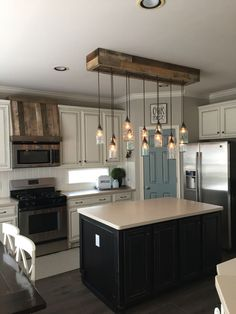 Find more ideas: Kitchen Lighting Fixtures Kitchen Lighting Over Island Farmhouse Kitchen Lighting Kitchen Lighting Ideas Kitchen Lighting Over Sink Kitchen Redo, Home Decor Kitchen, New Kitchen, Awesome Kitchen, Kitchen Ideas, Apartment Kitchen, Kitchen Cabinets, White Cabinets, Beautiful Kitchen