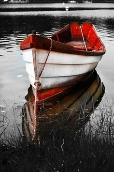 black and white with red boat