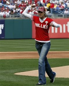 GAME 4, 4/9/12: Delaware's Elena Delle Donne throws out the first pitch before the home opener baseball game with the Philadelphia Phillies