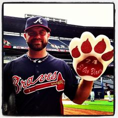 Evan Gattis poses with the official El Oso Blanco bear claw! Get yours at Braves.com/Gattis