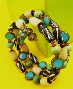 """This """"Wear Anywhere"""" Wrap Bracelet is strung on stainless steel memory wire and it wraps around your wrist three times in White Horns,Turquoise Rondelle/ Glass Beads, Mudd Barrels"""