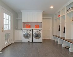 Laundry room and mudroom combination with doggy door and built-in lockers.