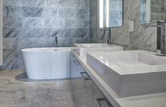 Spa inspired ensuite #bathrooms with deep soaker tubs and walk in glass showers.