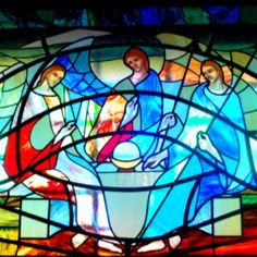 Holy Trinity in stained glass, reminiscent of Rublev's Icon