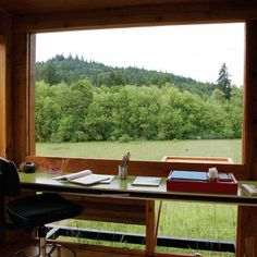"""A small writing studio (just 100sf) in the Willamette Valley, Oregon that the owner calls her """"Watershed."""" The owner is a philosophy professor and a well-known nature writer. She commissioned the studio as a retreat for herself and for visiting writer friends. Her first request was for a roof that would let her hear rain falling. Room with a view."""