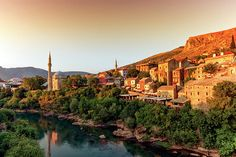 View of Neretva river and old city of Mostar old city by sunset, Bosnia and Herzegovina Famous Places, Old City, Bosnia And Herzegovina, Travel Photos, Fine Art America, Paris Skyline, Louvre, River, Sunset