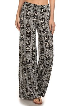Aztec Palazzo Pants - Livin' Freely These high waisted Aztec Palazzo Pants feature an elastic waist. They run long in length and look great paired with wedges or heels!