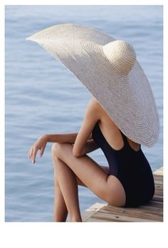 makes me smile thinking: one day I will buy her a big hat like this :)