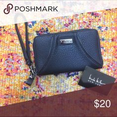 Nicole Miller clutch Never used black leather Nicole Miller small clutch with wrist strap and zipper detailing. Bags Clutches & Wristlets