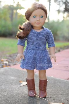 Dress by Anick's Boutique and boots are AG brand. American Girl