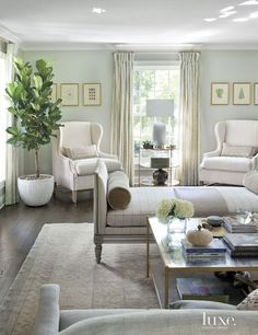 gorgeous living room with a beautiful chaise in a window pane fabric.