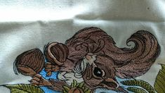 squirrel with hazelnut machine embroidery