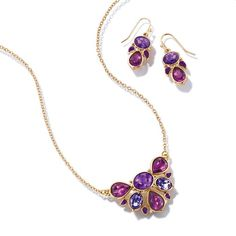 "ON SALE $4.99 Goldtone statement necklace and earring set with oval and teardrop shaped faux stones in shades of purple. · Necklace: 16 1/2"" L with Lobster Claw clasp · Extender: 3 1/2"" L with spring ring clasp · Earrings: Approx. 7/8"" x 15/32"" with Fish Hook with rubber stopper clutch · Imported"