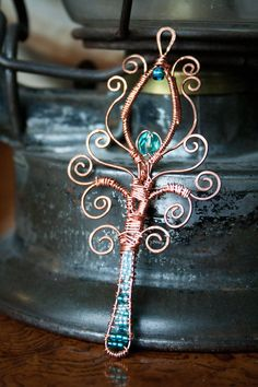 Wire wrap and beaded peacock feather pendant by ErinMalaspino, $32.00