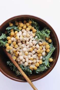 This Lemon Tahini Kale Salad with cheesy chickpeas is a light and refreshing salad to pair with all your summertime potlucks.