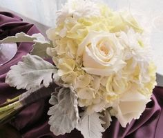 White roses and hydrangea accented with silver foliage.