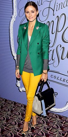 OLIVIA PALERMO Layering season is upon us, ladies. And we fully intend to take advantage by emulating Olivia's ensemble: a white tee, gray sweater and green blazer, all worn with yellow skinnies and cool neutral accessories.