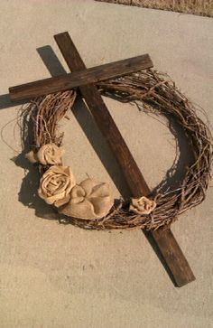 "36"" grapevine wreath with 1x4x 52"" cross, hand made barbed wire, and burlap rosettes for Easter"