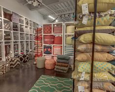 The use of hangers along the bottom row of the pillow wall allows for multiple colors and patterns to be shown in a more efficient, space-saving manner. This is from Surya's #LVMkt showroom. @lasvegasmarket