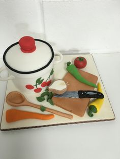 Cook pot cake with fondant veg, chopping board and utensils
