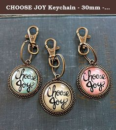 "CHOOSE JOY Keychain - 30mm - Antique Bronze. This beautiful ""Choose Joy"" Keychain is handlettered on a painted background and is approximately 1 1/2"" (30mm) in diameter. Choose from the Blue Painted, Pink Painted or the Tan Crackle background from the dropdown menu. The painting is under glass, in an Antique Bronze tray with a keychain ring and a large lobster clasp. Each keychain comes in an organza gift bag, ready for giving! Makes a great stocking stuffer! Wonderful mens gift! Designed..."